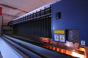 Image of large laser cutting sheet metal