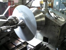 Image of spun cone on Flow Turn machine in process