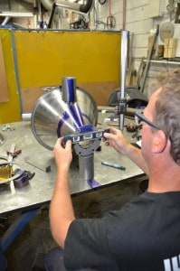 Assembly and Fabrication - Image of welder assembling spun part